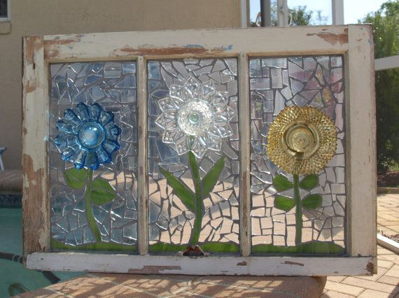 Beautiful....Glass glued to original glass and grouted and recycled dishes used for flowers