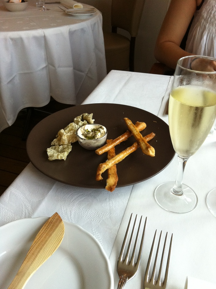 "Fish restaurant in north Jutland, called Snerlen. Snacks with dried fish skin, ""breadsticks"" - and cremant."