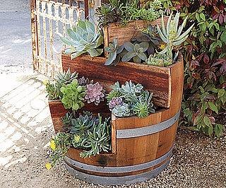 Modify a whiskey barrel for a pretty stepped planter.