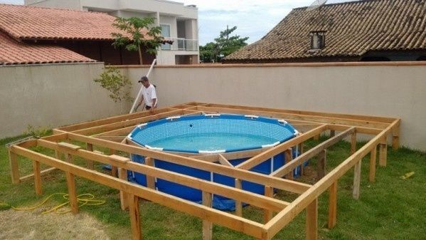 To make the pool a permanent fixture, he built out this wooden frame around it.