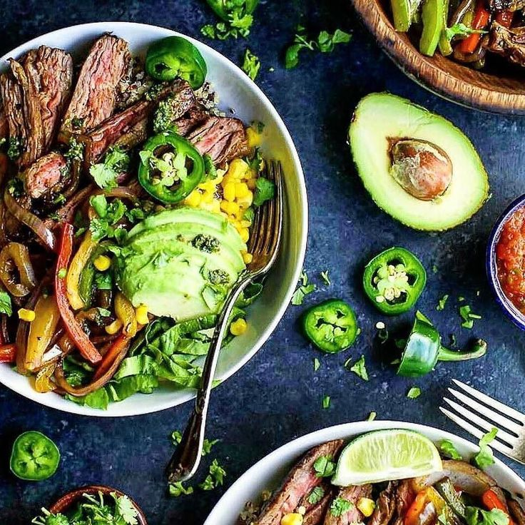 Summer cooking at its finest! Fresh produce and herbs liven up these grilled steak fajita burrito bowls with avocado and jalapeño heirloom tomato salsa lime and a garden of fresh herbs. Serve with ice cold cerveza! . Repost @bachelorsgrill  #fiesta #grill #grilling #carne #churrasco #farmtotable #fresh #organic #steak #paleo #tacos #mexican #spicy #beer #cerveza #meatlover #carnivore #paleo #summercooking #fajitas #avocado #heirloom #tomatoes #heirloomtomatoes #salsa #lime #herbs #jalapeno