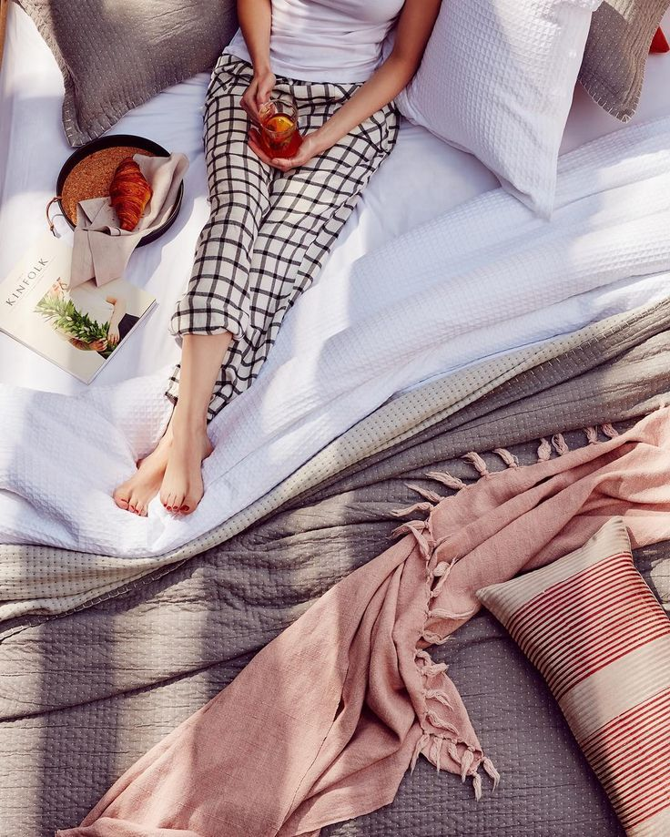 An ideal way to begin a fresh new year - with a croissant and tea in bed. Shop the Hayman blush throw Avenue cushion and Arc blanket online.