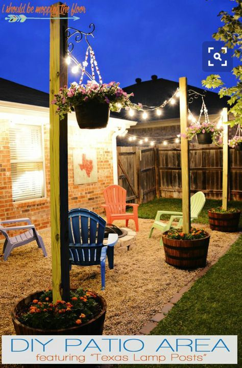 Cement posts in wine barrels, plant flowerbeds on top ! also love the rock DIY patio as opposed to boring and $$ cement