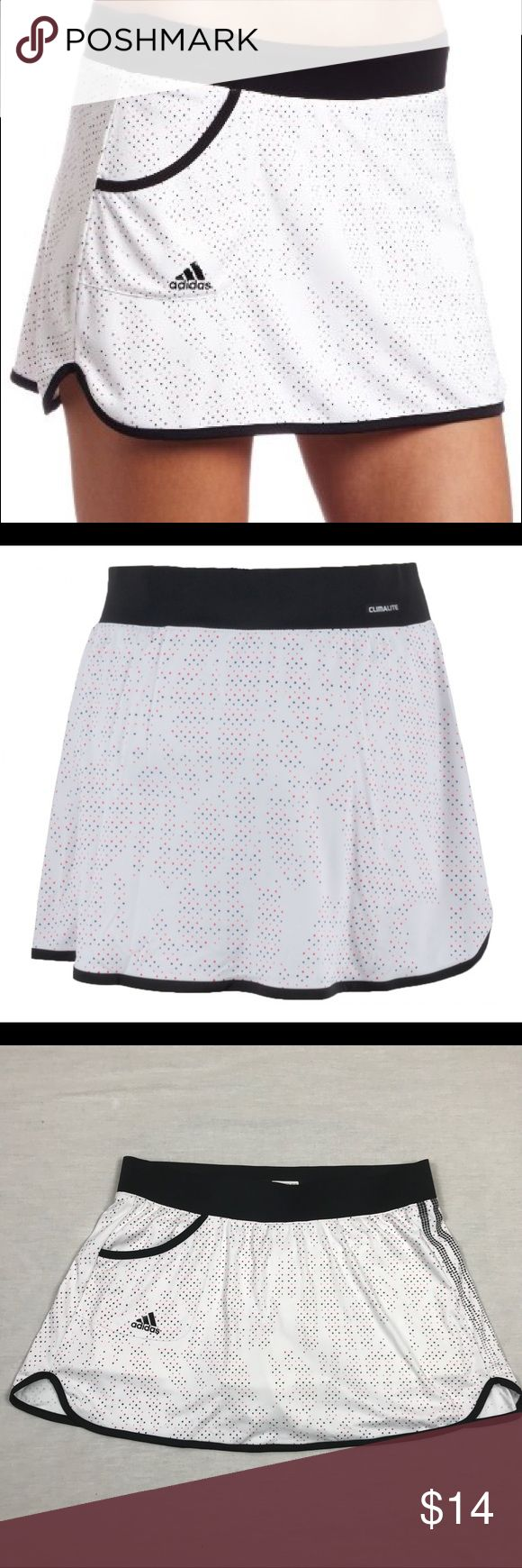 "Adidas Response Tennis Skort White Black ClimaLite This Adidas Response Tennis Skort is part of the Adidas tennis collection.  Size Medium. Machine wash.  The skirt has a comfortable feel and is made with the ClimaLite technology. It has a small pocket on the front side and a built-in short. This skirt has a lovely graphic print on the front and back side.  Specifications: Adidas women's skirt Fabric: 100% polyester Great pre-owned condition!! No flaws. Waist across laying flat 15.5"". Waist…"