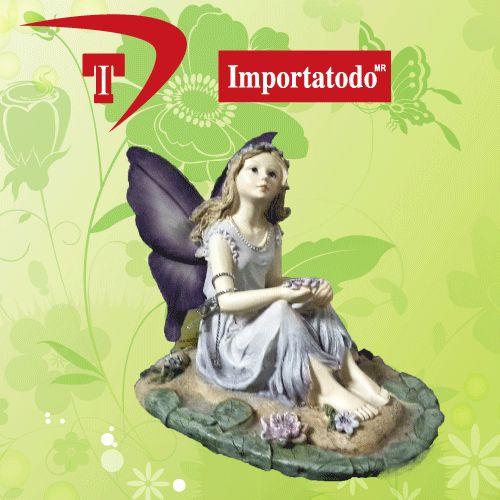 Figura Decorativa Hada sentada elaborada en Poliresina marca TRENTINO. Modelo 45-621.