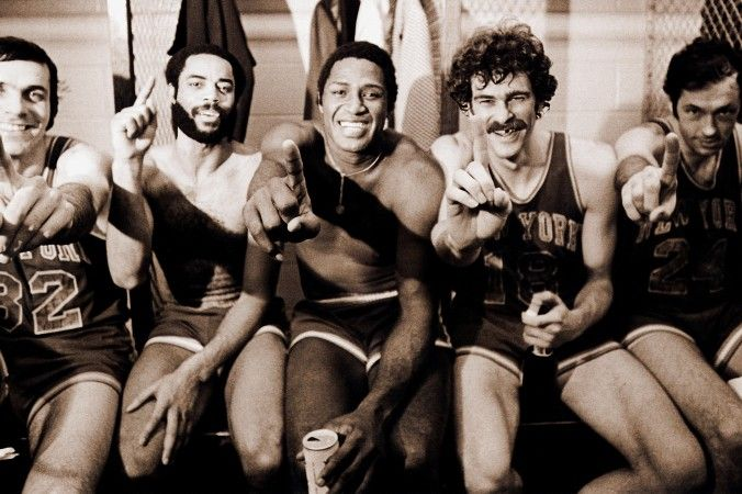 (L–R) Jerry Lucas, Walt Frazier, Willis Reed, Phil Jackson, and Bill Bradley celebrate after winning the 1973 NBA Title in five games against the Los Angeles Lakers. (George Kalinsky)