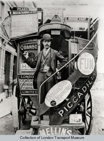 London General Omnibus Corporation horse bus conductor in bowler hat and long jacket standing on the boarding platform of the bus. The conductor sports a Bell punch ticket machine and enamel licence badge no 9116. His right hand is grasping the cord which communicates with the driver. ca 1895  London Transport