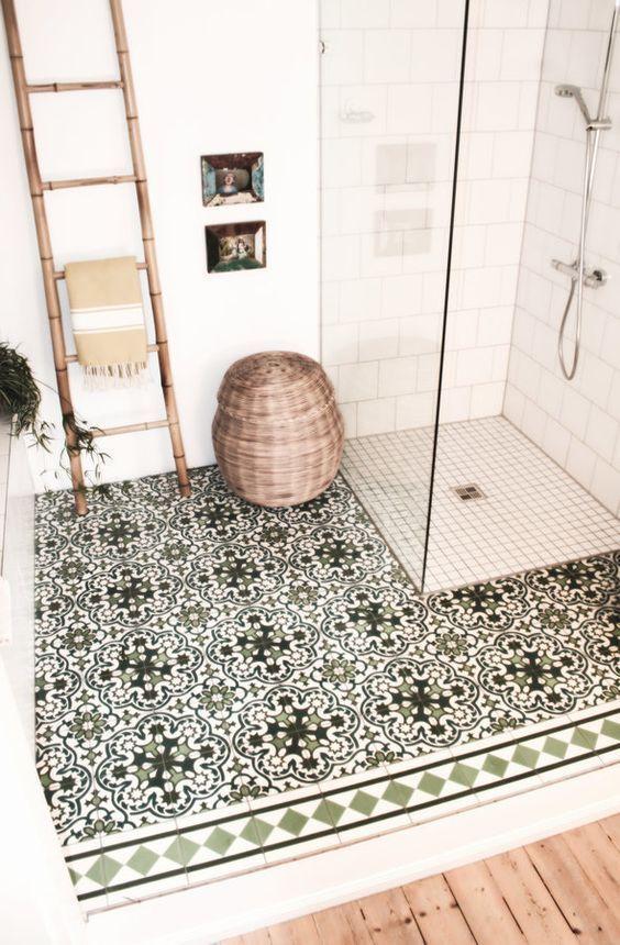 Green pattern floor tiles, basket, leaning towel ladder, shower