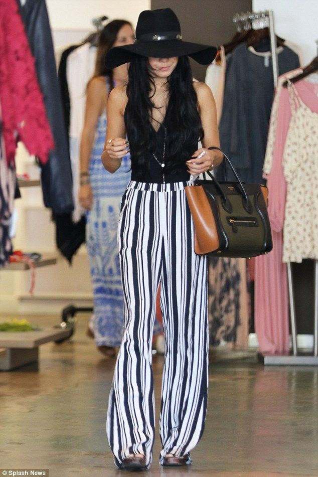 Backless boho style: Vanessa Hudgens showed off her sculpted figure in a revealing bodysuit as she shopped at Planet Blue in Beverly Hills, California on Wednesday