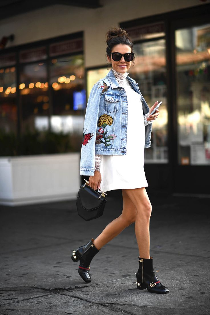 Embroidered denim jacket paired with a mini white lace dress
