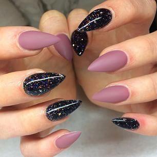 Black Galaxy polish with matte mauve stiletto nails
