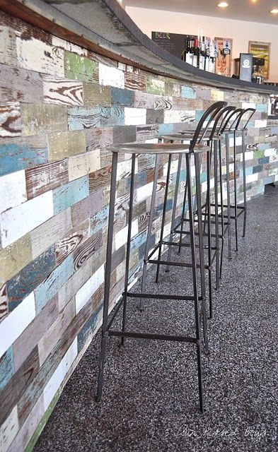 Reclaimed painted wood bar.   Can see this in a different setting and working well.   Leslieville feel to it.