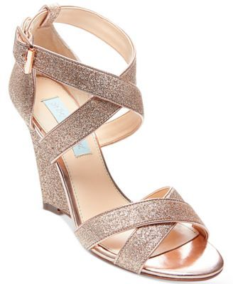 Blue by Betsey Johnson's Cherl wedges glam up your evening look with glitter in a sleek, crisscross strap design. | Manmade upper; manmade sole | Imported | Round open-toe crisscross-strap wedge dress