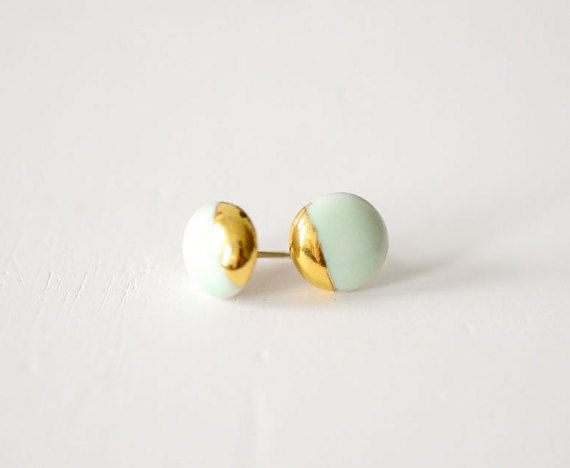 These are the classic and elegant, simple stud earrings. Designed to bend the light around the 22k gold melted to the surface of the porcelain,