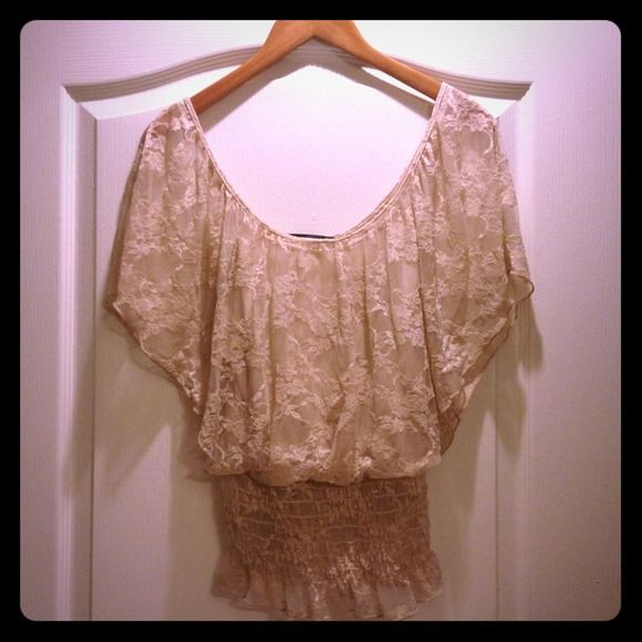 Beautiful Nude Lace Bohemian Smocked Top Size M. Top has built-in cami underneath. Upper part is loose fitting. Bottom is cropped with smock detail. Perfect for summer! Item is gently used and comes from a pet and smoke free home. Tops