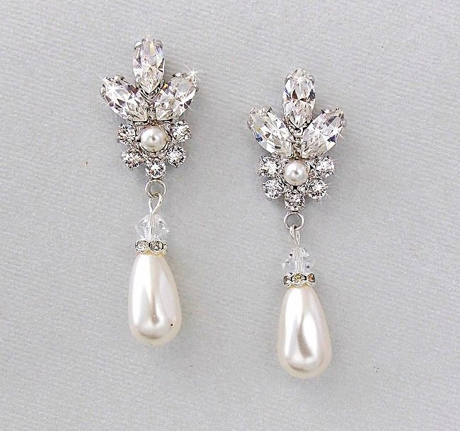 Alluring and elegant. Swarovski crystal and drop pearl earrings are the perfect accessory.