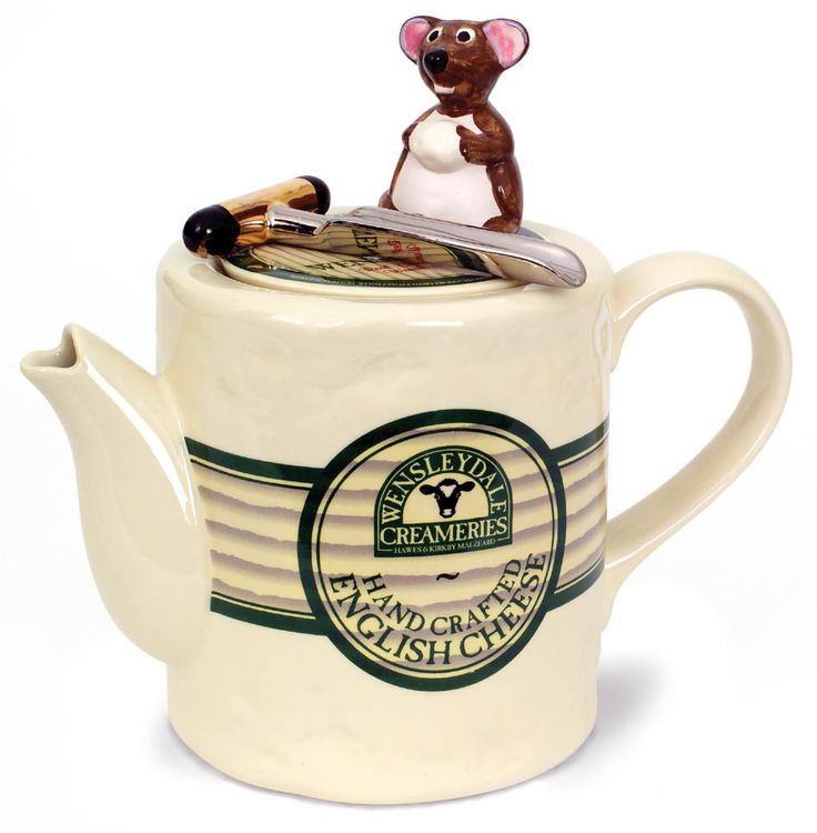"""More cheese Gromit"" This is a teapot for the cheese lover. Can you resist the little mouse?Primed to use his cheese iron!"