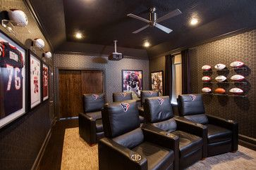This must be a Houston Texans fan! A ceiling fan is crucial in the sultry South, but the memorabilia is elegantly and smoothly lit as well.