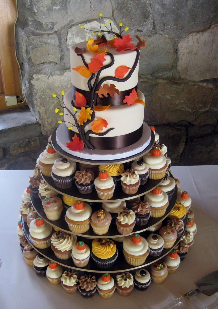 """2 tier Autumn cutting cake & assorted cupcakes - Cake design inspired by Pink Cake Box  6"""" & 8"""" rounds with assorted regular and mini cupcakes."""
