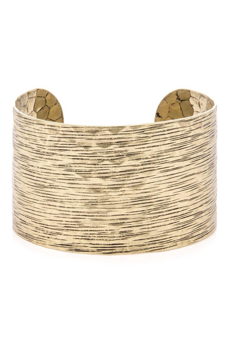 Bracelet manchette en métal doré et rayé