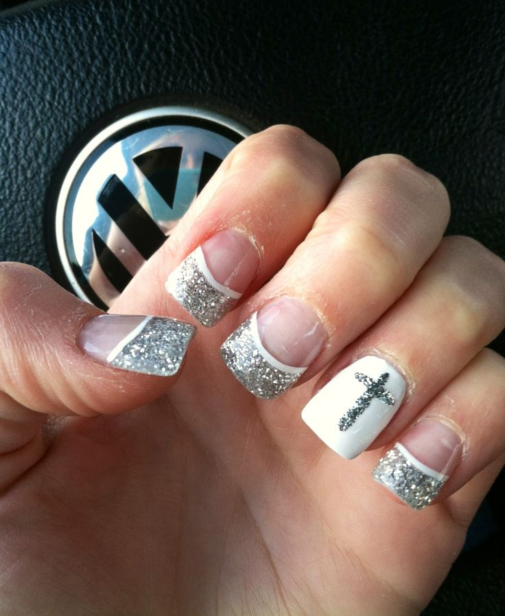 Silver sparkle tip nails with cross on ring finger. Adorbs.