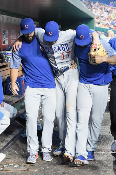 Kris Bryant tripped over third base on a foul ball and sprained his ankle