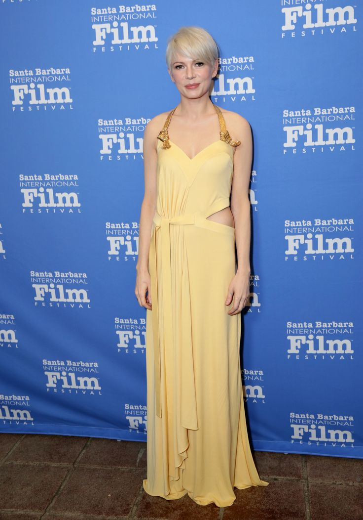 Michelle Williams wearing a custom Louis Vuitton cut-out jersey dress with embellished straps and sandals to the 32nd Santa Barbara International Film Festival.