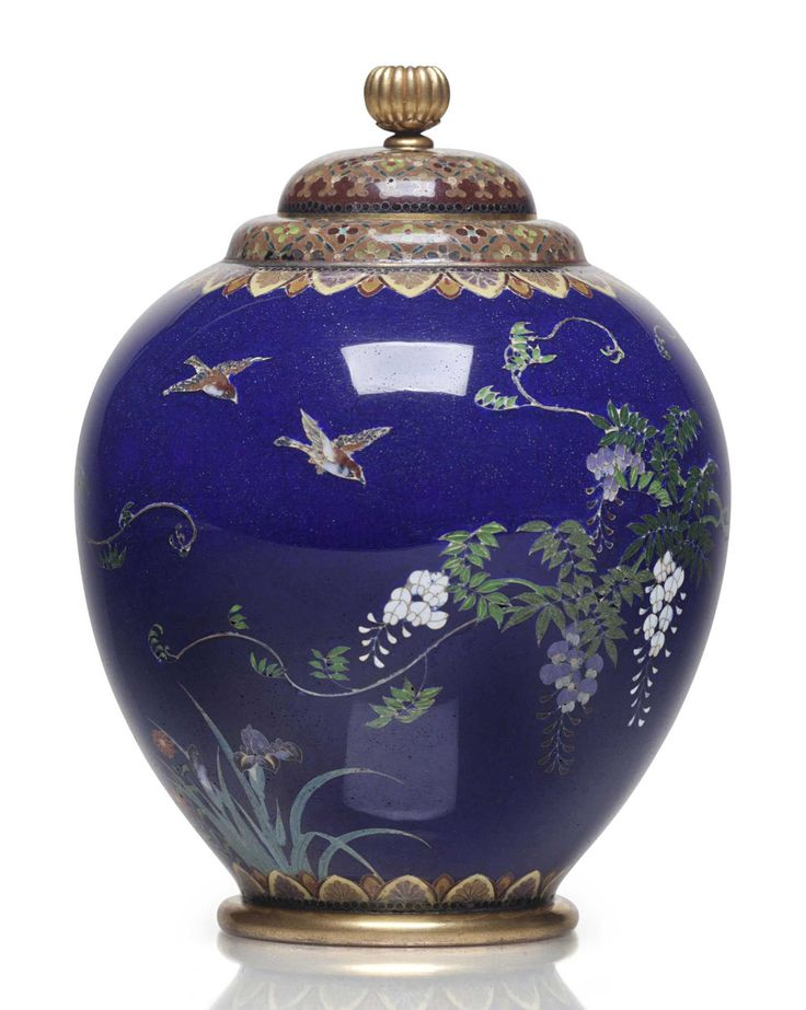 A cloisonné enamel jar and cover Meiji period (late 19th century), signed Kyoto Namikawa (Workshop of Namikawa Yasuyuki; 1845-1927) The bulbous jar decorated in polychrome enamels and silver wires with trailing branches of wisteria and sparrows on a blue ground, the lid and mouth rim enamelled with a floret pattern, the shoulder and base with floral lappets, the lid set with a gilt chrysanthemum finial, signature on a silver tablet mounted on base