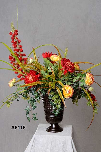 Asymmetrical flower arrangement, beautiful touch for a hall chest or for top of the mantle.