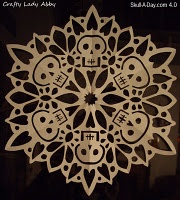 """Skull Doily"" Tutorial and a new blog skull a day-- this in black and orange would be good for Halloween.: Skull Paper, Lady Abby, Sugar Skull, Paper Snowflakes, Of The, Crafty Lady, Dead, Day, Skull Snowflakes"