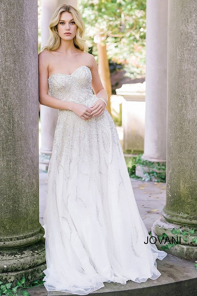 Beautiful off white floor length silk chiffon embellished bridal gown features strapless sweetheart neckline bodice and a train.