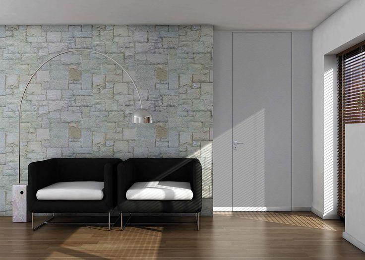 La porta a filo muro Walldoor di Bertolotto Porte è reversibile, cioè permette in fase d'installazione di stabilire il senso di apertura, invertendo il posizionamento del telaio e la spinta di apertura (destra o sinistra). Ha il telaio in alluminio estruso e ossidato e il pannello in tamburato che può essere personalizzato per colore e materia come la superficie della parete. La porta è dotata di serratura magnetica con chiave. Misura 80x210 cm. Prezzo da rivenditore. www.bertolotto.com