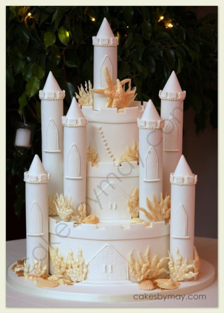 Sand Castle Wedding Cake  Sand Castle Wedding Cake Seashells and coral were made of white chocolate.  #castle #fairy-tale #fairy #hogwarts #dragon #cakecentral