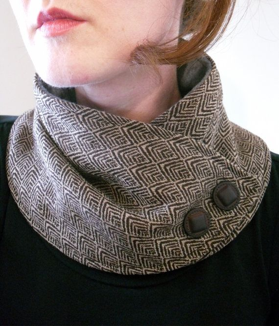 Unique print brown and cream neck warmer. Made from soft wool blend fabric. Backed with gray fleece. Adorned with brown buttons. Secures around neck with snap. This neck warmer is a Christina Robinson original design. Please check out my policies section before making your purchase. http://www.etsy.com/shop/OhMaudlinMe/policy Thanks