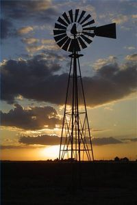 A typical windmill can be converted to generate enough electricity to power a modest sized home. Using the windmill to recharge a battery bank suited to the needs of the home is the simplest and most effective method of wind power storage. The average backyard engineer can convert a windmill to generate electricity in about four hours.