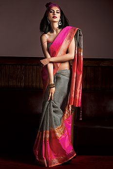 Explore and imbue the season's most exquisite collection of sarees, crafted to perfection.   BenzerWorld
