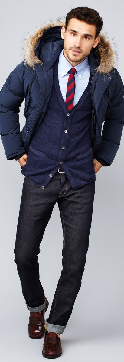 This combination of a navy parka and dark grey jeans is perfect for a night out or smart-casual occasions. Burgundy leather loafers are a good choice to complete the look.  Shop this look for $186:  http://lookastic.com/men/looks/loafers-jeans-belt-cardigan-parka-tie-dress-shirt/5039  — Burgundy Leather Loafers  — Charcoal Jeans  — Black Leather Belt  — Navy Cardigan  — Navy Parka  — Red and Navy Vertical Striped Tie  — Light Blue Dress Shirt