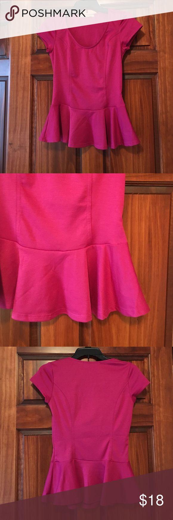 Dark pink peplum top. Size small. Dark pink peplum top. Size small. Never worn :) Tops