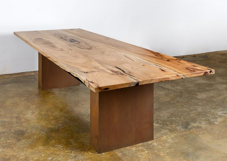 Ore Dining table is handcrafted in Yallingup using Marri slabs and a rust base inspired by our unique outback.A real feature piece for any home can be built to size.