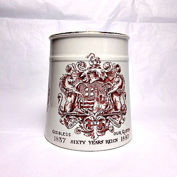 Beautiful antique cup commemorating the 1897 Diamond Jubilee of Queen Victoria. It features the coat of arms of the city of Bristol and was presented by the Bristol ward of St. Augustine.