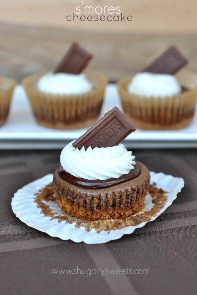 S'mores Cheesecakes: individual cheesecakes topped with chocolate ganache, marshmallow frosting and Hersheys!