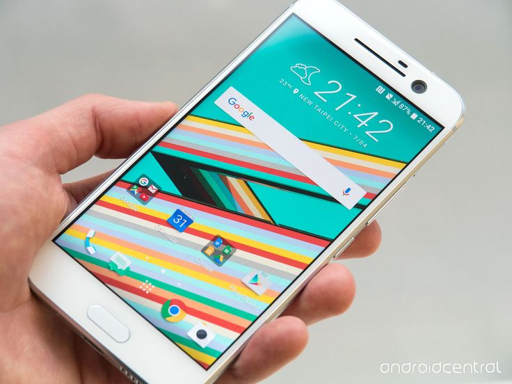 White HTC 10 smartphone in a man's hand. To place your app screenshot in this image, use the Image Customizer tool on PicApp.net.