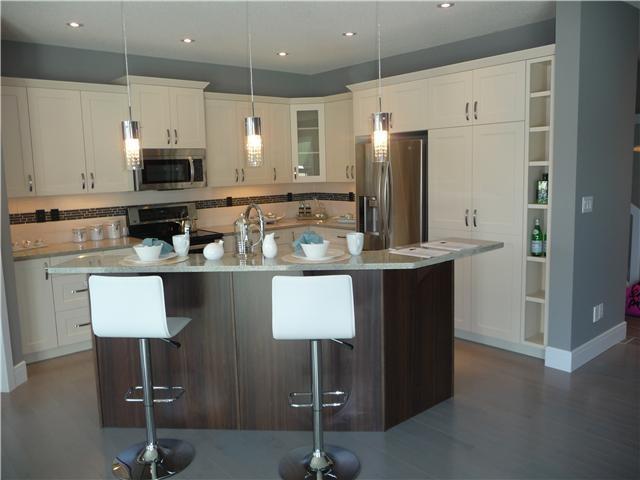 Slate grey maple hardwood floors.  Very unique design in new home. MLS# E3315469