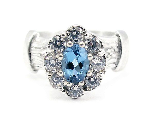 Oval Cluster setting with Blue Topaz and by NatashaGjewellery, $230.00