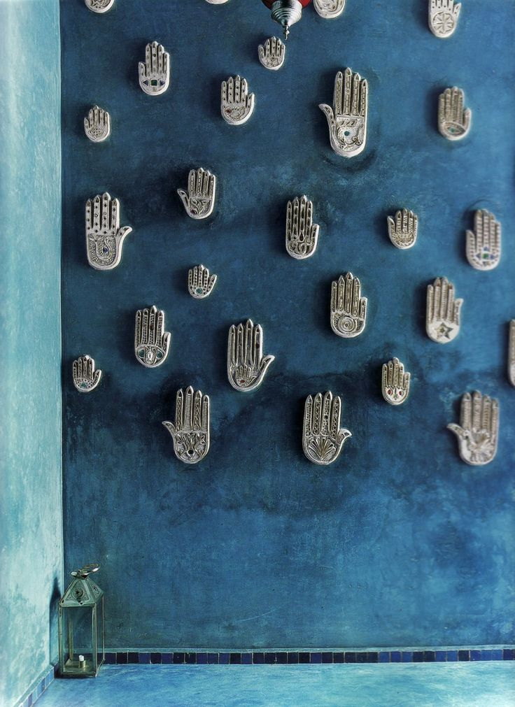 Khamsa (or Hand of Fatima) is a palm-shaped amulet popular throughout the Middle East and North Africa. The khamsa is often incorporated in jewelry and wall hangings, as a superstitious defense against the evil eye