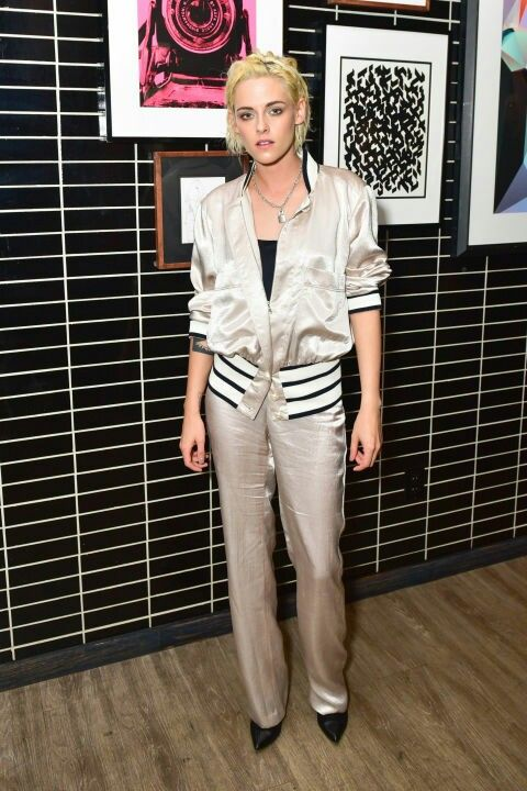 Kristen Stewart doing a retro normcore turn at a party in a shell suit