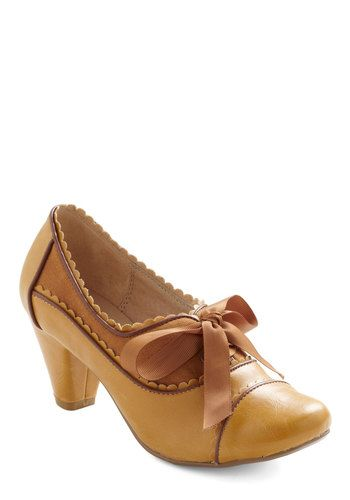 How adorable is this 1930's style shoe? Oxford with big lace bow in several colors. Sold at Modcloth.