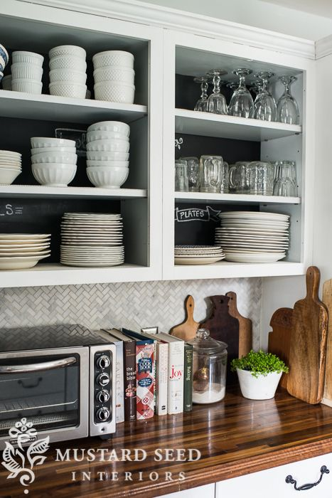 Love the chalkboard on back of  open shelving with white dishes -the evolution of my house | part 4 | the kitchen - Miss Mustard Seed