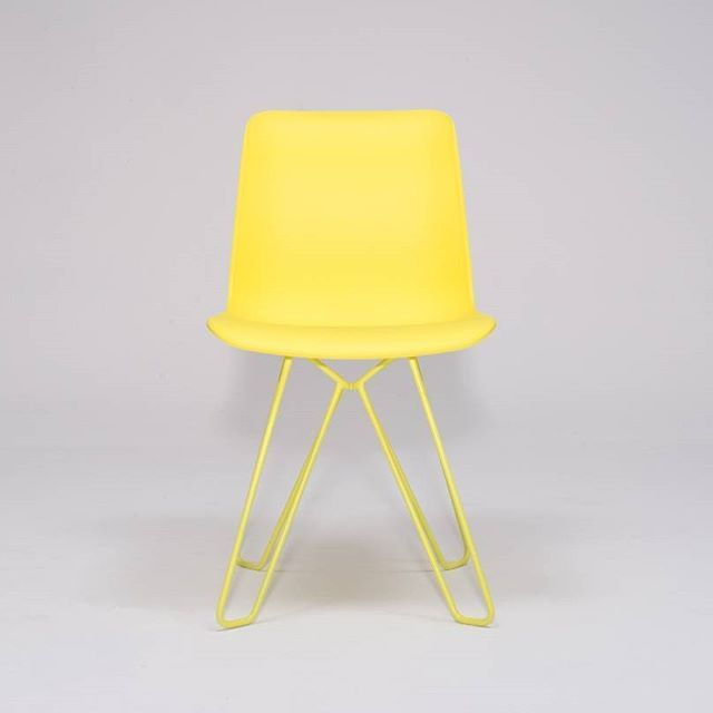 A thoroughly modern entry. The SCHÄFER chair in sulfur yellow.