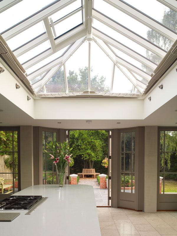 An orangery roof in the form of a rectangular roof lantern above a kitchen island
